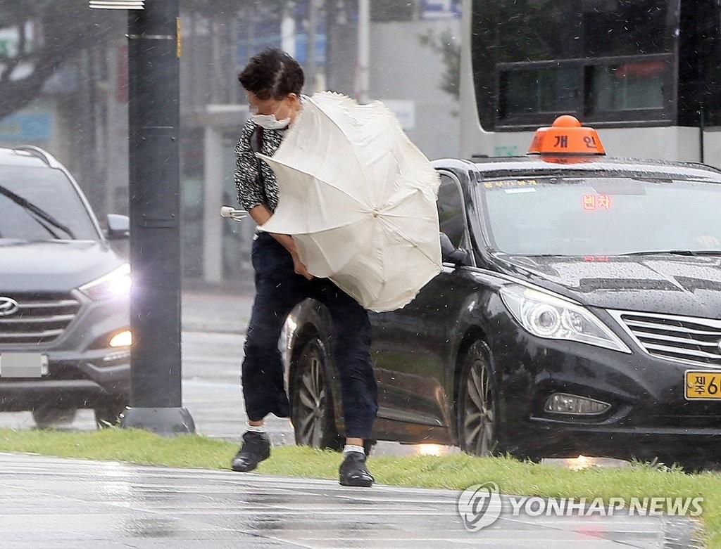 North Korean leader Kim calls for prevention efforts against coronavirus, looming typhoon