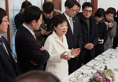 This photo, provided by the presidential office Cheong Wa Dae on Jan. 1, 2017, shows President Park Geun-hye speaking with the press at her residence in Seoul. (Yonhap)
