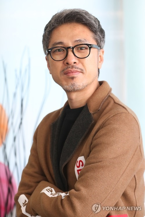 "Park Kwang-hyun, director of ""Fabricated City,"" poses for a photo before an interview with Yonhap News Agency on Feb. 6, 2017. (Yonhap)"