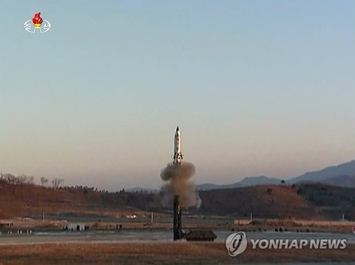(LEAD) N.K. unveils footage of new ballistic missile launch