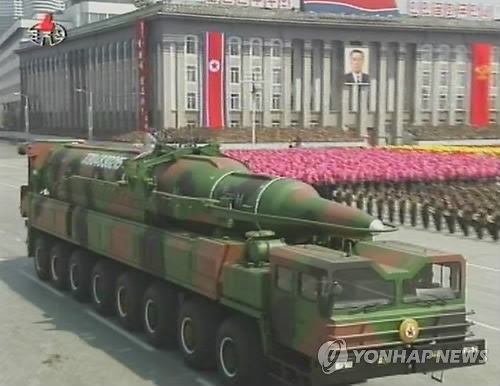 This image captured from footage of North Korea's state-run broadcaster on April 15, 2012, shows North Korea holding a military parade at a plaza in Pyongyang on the 100th birthday of late founder Kim Il-sung. (Yonhap)