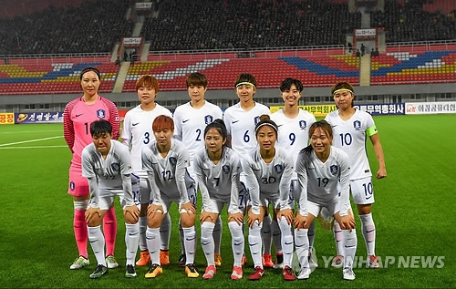 The South Korean women's national football team pose for a group photo at Kim Il-sung Stadium in Pyongyang on April 5, 2017, before the kickoff of the 2018 AFC Women's Asian Cup Group B qualifier against India. (Joint Press Corps)