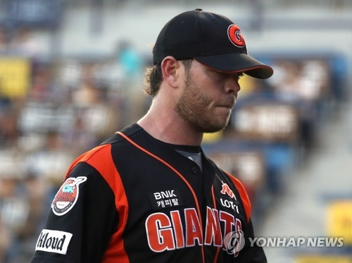 In this file photo taken on June 8, 2017, Nick Additon of the Lotte Giants leaves the mound after giving up five runs in the bottom of the first inning against the NC Dinos in their Korea Baseball Organization game at Masan Stadium in Changwon, South Gyeongsang Province. (Yonhap)