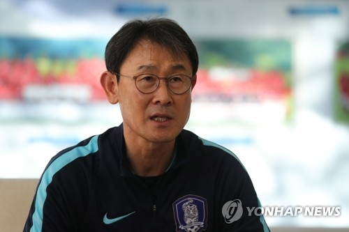 In this file photo taken on Nov. 27, 2017, South Korea women's national football team head coach Yoon Duk-yeo speaks to reporters at the National Football Center in Paju, north of Seoul. (Yonhap)