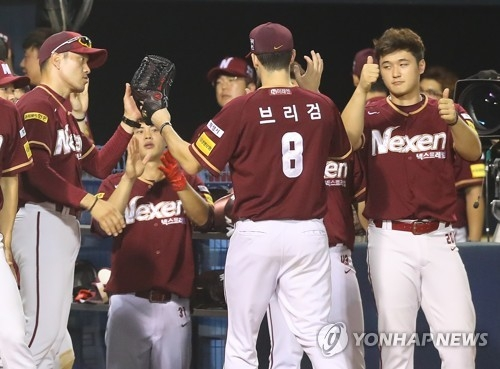 In this file photo taken July 25, 2017, Jake Brigham of the Nexen Heroes (No. 8) is greeted by teammates after completing the seventh inning of a Korea Baseball Organization regular season game against the LG Twins at Jamsil Stadium in Seoul. (Yonhap)