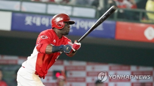 In this file photo from May 2, 2018, Roger Bernandia of the Kia Tigers hits a triple against the Lotte Giants in a Korea Baseball Organization regular season game at Sajik Stadium in Busan, 450 kilometers southeast of Seoul. (Yonhap)