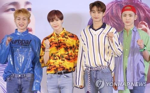 "SHINee members -- Onew, Taemin, Minho and Key (from L) -- pose for photos during a press conference for their new album ""The Story of the Light"" on June 11, 2018. (Yonhap)"