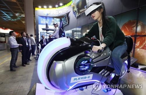 This file photo shows a person trying out a VR game system. (Yonhap)