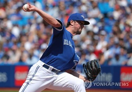In this Getty Images file photo from May 24, 2018, Deck McGuire, then with the Toronto Blue Jays, delivers a pitch against the Los Angeles Angels in the top of the eighth inning of a Major League Baseball regular season game at Rogers Centre in Toronto. (Yonhap)