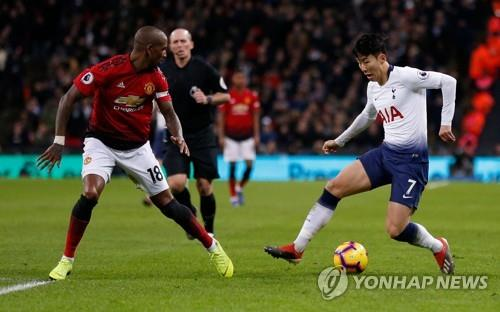 In this AFP photo, Tottenham Hotspur's South Korean forward Son Heung-min (R) dribbles against Manchester United's English midfielder Ashley Young during an English Premier League football match between Tottenham Hotspur and Manchester United at Wembley Stadium in London on Jan. 13, 2019. (Yonhap)