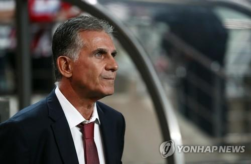 In this file photo taken Aug. 31, 2017, then Iran national football team head coach Carlos Queiroz awaits a 2018 FIFA World Cup Asian qualifying match between South Korea and Iran at Seoul World Cup Stadium in Seoul. (Yonhap)