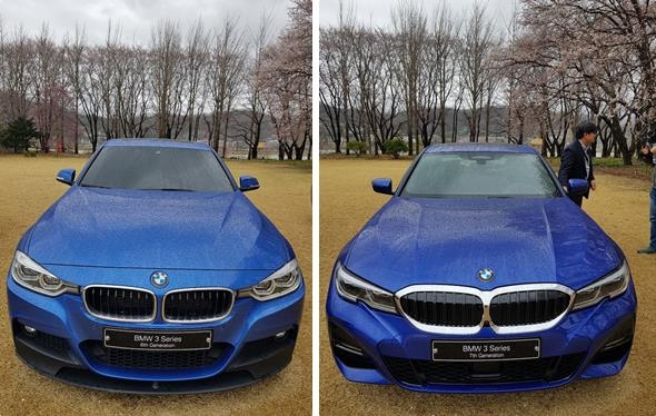 These photos taken April 9, 2019, show the front of the sixth-generation BMW 320i model (L) and the seventh-generation BMW 330i model on display in Yangpyeong, 55 kilometers east of Seoul. (Yonhap)