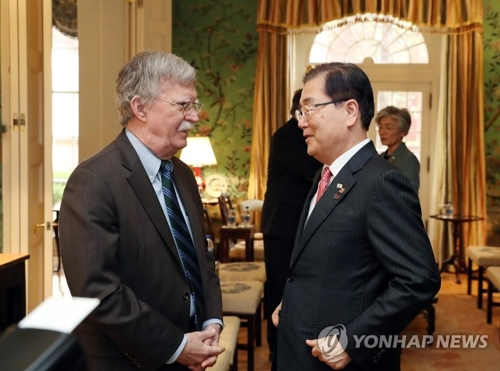 This file photo, taken April 11, 2019, shows U.S. National Security Adviser John Bolton (L) talking with his South Korean counterpart, Chung Eui-yong, at Blair House in Washington, D.C. (Yonhap)
