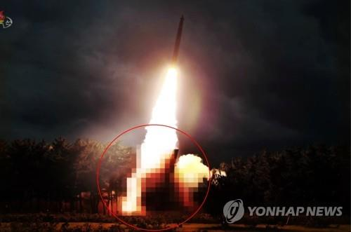 This blurred photo, captured from the North's Korean Central TV on Aug. 1, 2019, shows the North's newly-developed large-caliber multiple launch guided rocket system. (For Use Only in the Republic of Korea. No Redistribution) (Yonhap)