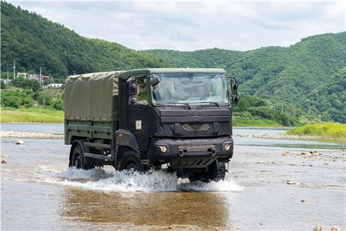 This undated file photo provided by Kia Motors shows a 2.5-ton military vehicle crossing a river during a test. (PHOTO NOT FOR SALE) (Yonhap)