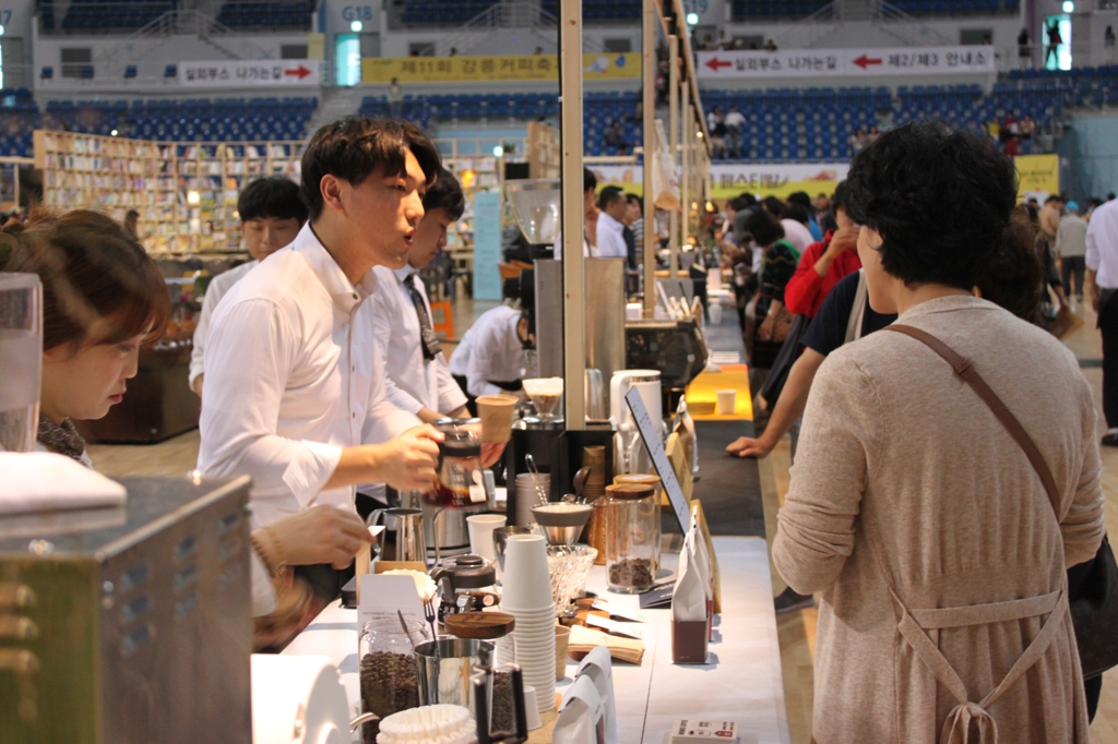 A barista prepares to serve hand-drip coffee at the 11th Gangneung Coffee Festival. (Yonhap)