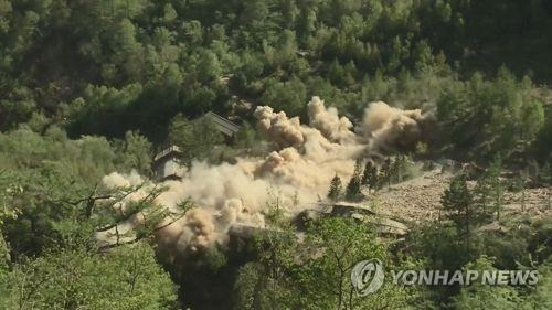 This file photo taken in May 2018 shows the demolition of North Korea's Punggye-ri nuclear testing facility. (Yonhap)