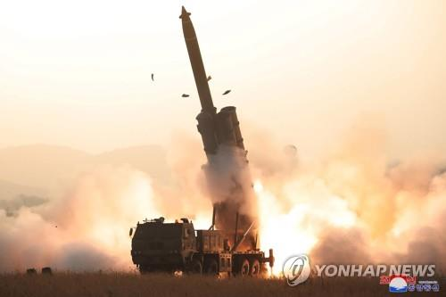 "A projectile mounted on a super-large multiple rocket launcher is launched from North Korea's western region toward the East Sea on Oct. 31, 2019, in this photo released by the North's official Korean Central News Agency (KCNA) the next day. According to the KCNA, the North successfully tested a super-large multiple rocket launcher, verifying the ""perfection"" of the weapons system. (For Use Only in the Republic of Korea. No Redistribution) (Yonhap)"