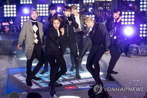 This AP photo shows BTS performing at the Times Square New Year's Eve celebration on Tuesday, Dec. 31, 2019, in New York. (Yonhap)