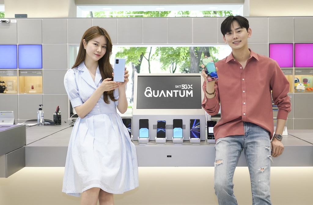In this photo provided by SK Telecom Co. on May 14, 2020, models promote the Galaxy A Quantum smartphone with QRNG chipset. (PHOTO NOT FOR SALE) (Yonhap)