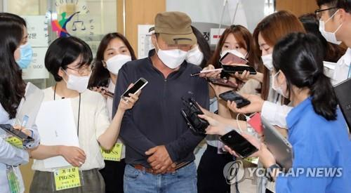 The father of the criminal Son Jung-woo, who ran one of the world's biggest child porn sites, talks to reporters after the second hearing in his son's case at the Seoul High Court in Seoul on June 16, 2020. (Yonhap)