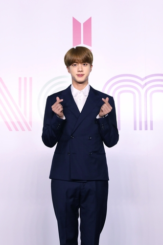 """Jin of K-pop sensation BTS poses for photos during an online press conference for the new single """"Dynamite"""" held in Seoul on Aug. 21, 2020, in this photo provided by Big Hit Entertainment. (PHOTO NOT FOR SALE) (Yonhap)"""