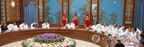 "This photo, released by the Korean Central News Agency (KCNA) on July 26, 2020, shows an emergency politburo meeting of the Workers' Party under way over the new coronavirus. At the center is North Korean leader Kim Jong-un. The KCNA said Kim adopted a decision to shift to a ""maximum emergency system"" against the coronavirus in the meeting. (For Use Only in the Republic of Korea. No Redistribution) (Yonhap)"