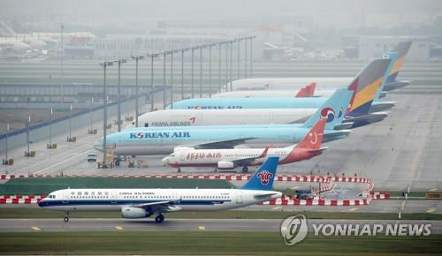 This file photo, taken July 29, 2020, shows planes parked at Incheon International Airport, west of Seoul. (Yonhap)