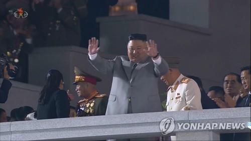 North Korean leader Kim Jong-un waves as he attends a military parade to mark the 75th founding anniversary of the ruling Workers' Party, held in Pyongyang on Oct. 10, 2020, in this photo captured from the Korean Central Television. (For Use Only in the Republic of Korea. No Redistribution) (Yonhap)