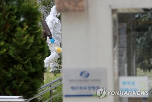 A disinfection worker enters a nursing hospital located in the southern port city Busan's Mandeok neighborhood on Oct. 14, 2020. (Yonhap)