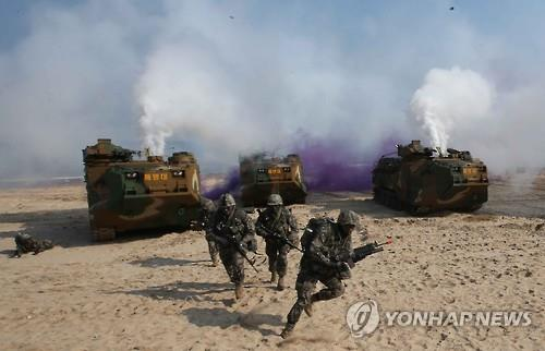 South Korean Marines and amphibious landing vehicles conduct a landing drill on a beach in the southeastern industrial city of Pohang on Nov. 3, 2016. The maneuver is part of the broader two-week Hoguk defense exercise, which the Army, Navy, Marine Corps and Air Force have carried out annually since 1996. (Yonhap)