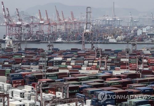 This file photo, taken June 4, 2020, shows stacks of import-export cargo containers at South Korea's largest seaport in Busan, 450 kilometers southeast of Seoul. (Yonhap)
