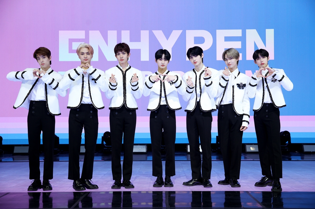 This photo, provided by Belift Lab, shows members of rookie boy band ENHYPEN posing for a photo during a media showcase held online on Nov. 30, 2020. (PHOTO NOT FOR SALE) (Yonhap)