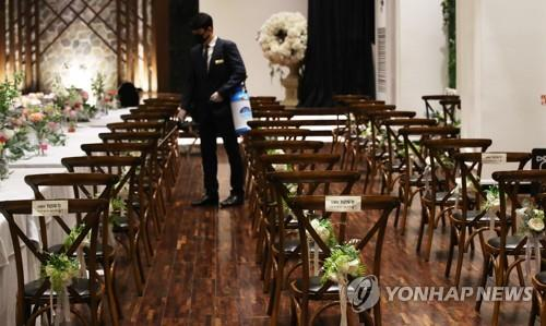 An employee disinfects a wedding hall in Suwon, Gyeonggi Province, ahead of a wedding ceremony on June 7, 2020. (Yonhap)