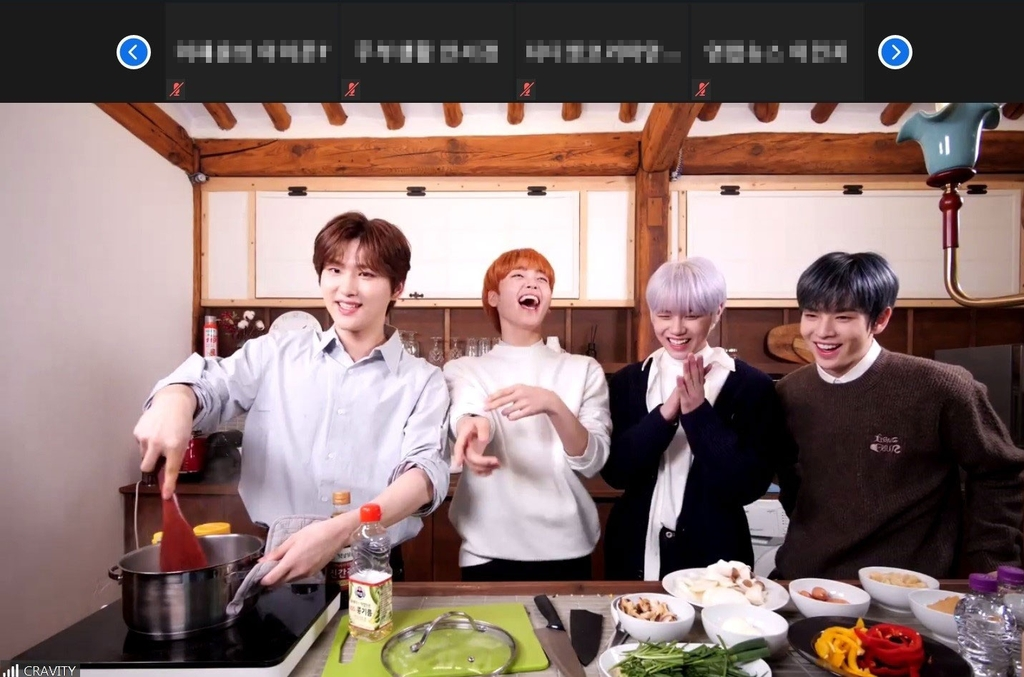 This photo, provided by Airbnb, shows K-pop boy band Cravity cooking a Korean dish during an online session hosted by the American accommodation rental company. (PHOTO NOT FOR SALE) (Yonhap)