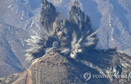 In this file photo, released by the South Korean defense ministry on Nov. 20, 2018, a North Korean guard post is demolished inside the Demilitarized Zone separating the Koreas. North Korea exploded 10 guard posts in the DMZ the same day as part of an inter-Korean agreement to withdraw them to reduce tensions and prevent accidental clashes, Seoul's defense ministry said. (Yonhap)