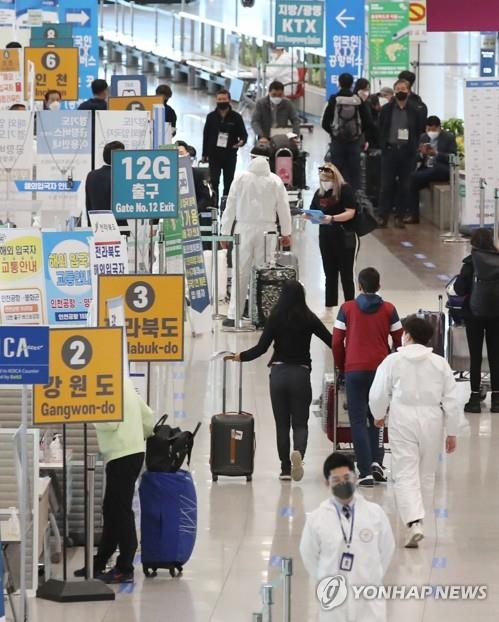 Arriving passengers are seen at Incheon airport, west of Seoul, amid the coronavirus pandemic in the file photo taken April 19, 2021.