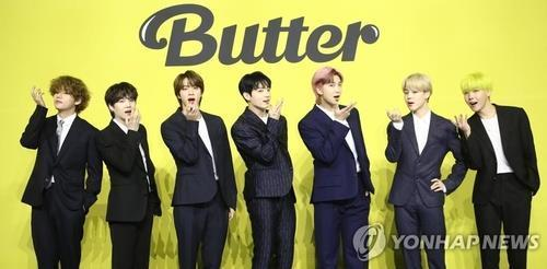 """In this file photo taken on May 21, 2021, BTS poses during a news conference for its new digital single """"Butter."""" (Yonhap)"""