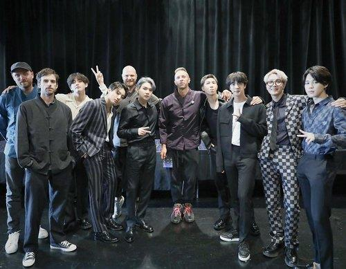 This photo, captured from BTS' Twitter account on Sept. 23, 2021, shows the K-pop act and Coldplay in New York. (PHOTO NOT FOR SALE) (Yonhap)