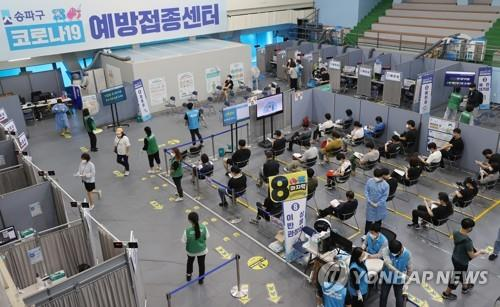 Citizens wait after receiving coronavirus vaccine shots at a COVID-19 vaccination center in Seoul on Oct. 1, 2021. (Yonhap)