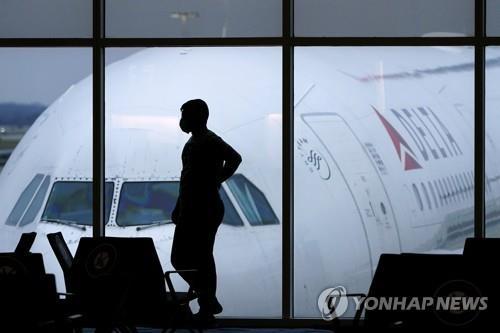 '노 마스크 난동' 항공기 승객들에 100만달러 과태료 처분