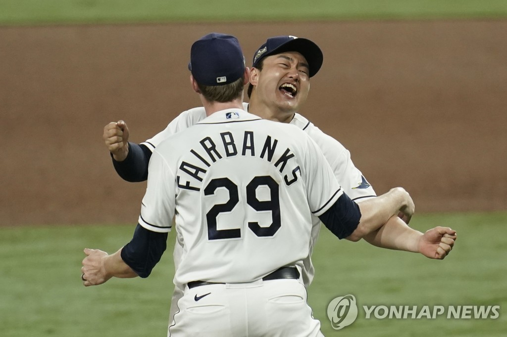 In this Associated Press photo, Choi Ji-man of the Tampa Bay Rays (R) celebrates with teammate Pete Fairbanks after their 4-2 victory over the Houston Astros in Game 7 of the American League Championship Series at Petco Park in San Diego on Oct. 17, 2020. (Yonhap)
