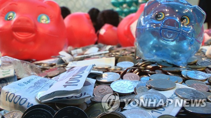 The image captured by Yonhap News TV, News Y, shows a pile of coins from piggy banks collected as part of a recent campaign by the Bank of Korea to use and recycle coins stashed away in people's homes. The campaign ended at the end of May 2019, resulting in 221 million coins, worth 32.2 billion won, being put back into the market, according to the central bank. (Yonhap)