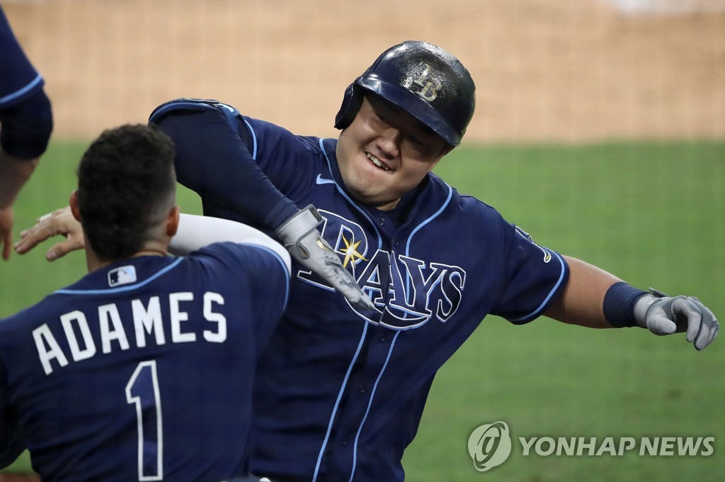 In this Getty Images photo, Choi Ji-man of the Tampa Bay Rays (R) celebrates his two-run home run against the New York Yankees' starter Gerrit Cole with teammate Willy Adames during the bottom of the fourth inning of Game 1 of their American League Division Series at Petco Park in San Diego on Oct. 5, 2020. (Yonhap)