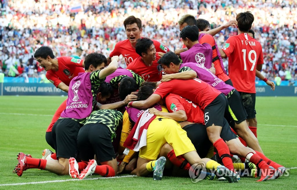 In this file photo taken on June 27, 2018, South Korea national football team players celebrate after scoring a goal against Germany in a Group F match at the 2018 FIFA World Cup at Kazan Arena, Kazan, Russia. (Yonhap)