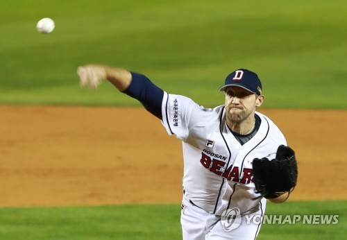 U.S. pitcher sues ex-club in S. Korea over unpaid buyout