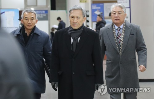 Ex-defense chief at trial