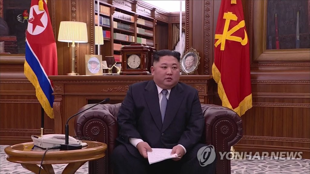This photo, captured from North Korean state TV, shows leader Kim Jong-un delivering a New Year's address on Jan. 1, 2019. (For Use Only in the Republic of Korea. No Redistribution) (Yonhap)