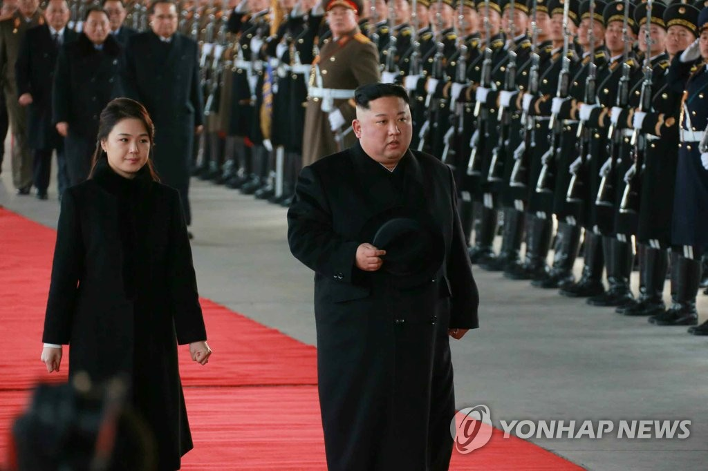 North Korea's leader Kim Jong-un (R) and his wife, Ri Sol-ju, leave for China in this photo from the North's Korean Central News Agency on Jan. 8, 2019. The report said Kim will visit China from Jan. 7-10 at the invitation of Chinese President Xi Jinping. (For Use Only in the Republic of Korea. No Redistribution) (Yonhap)