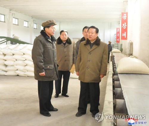 Choe Rong-hae inspects fertilizer factory